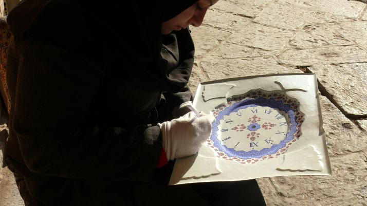 Isfahany Minaturist Artist working on a clock
